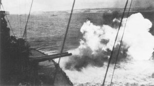 Photograph of           battleship Maryland firing at targets on Okinawa