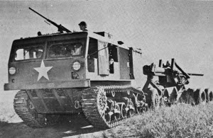 "Photograph of U.S. M4 HST towing a ""Long                 Tom"""