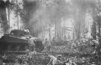 Photograph of tanks and infantry advancing