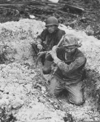 Photograph of troops attempting to entrench in coral