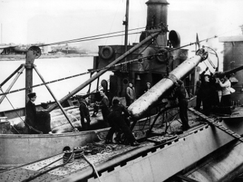 Photograph of Mark           VIIItorpedo being loaded onto submarine in Polish service