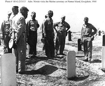 Photograph of Nimitz and senior officers paying their respects at a Marine cemetary