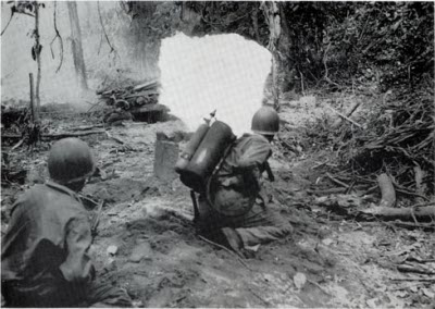 Flamethrowers attacking a Japanese bunker