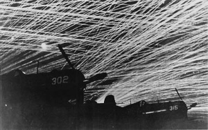 Photograph of heavy antiaircraft fire around friendly aircraft