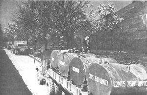 Photograph of gasoline containers being         transported by truck