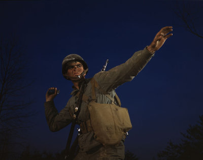 Photograph of soldier throwing grenade
