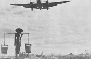 Photograph of air transport and Chinese peasant