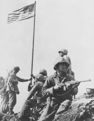 The first flag goes up at Suribachi