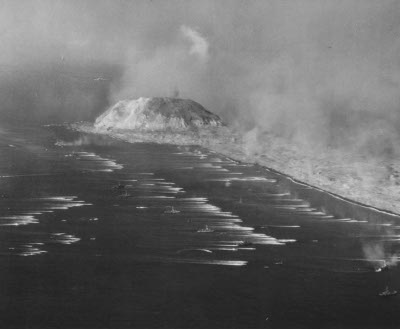 Photograph of landing craft approaching Iwo Jima