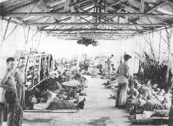 Photograph of malaria patients in a makeshift ward on Guadalcanal