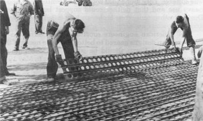 Photograph of engineers laying Marston mat