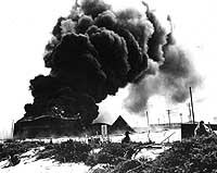 Burning facilities on Midway following Japanese air strike