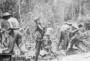 Photograph of           British soldiers firing a 76mm mortar