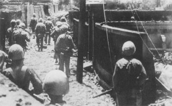 Photograph of Marines entering Naha