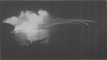 Photograph of naval bombardment at night