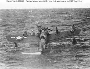 Photograph of OS2U rescuing aviators from Truk lagoon