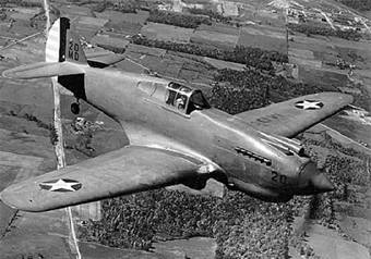 Photograph of P-40 Warhawk in flight