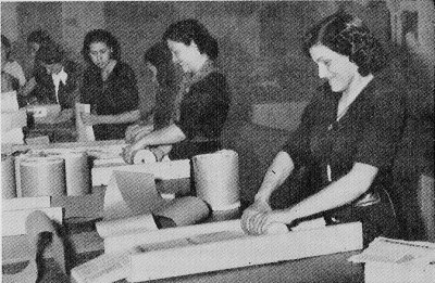 Photograph of women preparing leaflet bombs