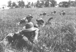 Photograph of KNIL infantry on drill