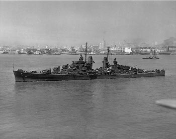 Photograph of San Francisco Bay with cruiser Oakland in foreground