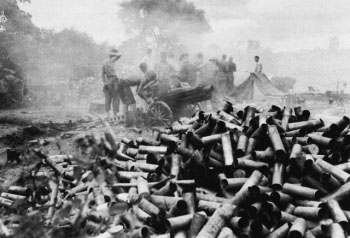 Photograph of a pile of expended shell casings at the seige of Mytikyina