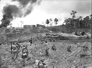 Photograph of Australian troops advancing on Tarakan