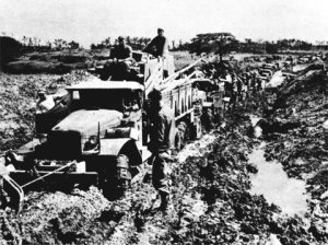 Photograph of truck at Okinawa, stuck in the mud