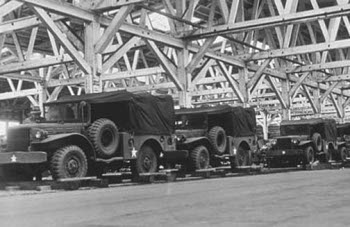 Photograph of WC 51 trucks preparing to embark