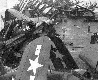 Photograph of Attu with wrecked aircraft on                   flight deck