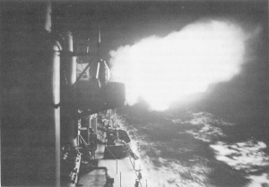 Photograph of U.S. warship firing on Japanese destroyers, 18 August 1943